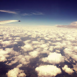 From the Airplane window by Igna Roos - Landscapes Cloud Formations