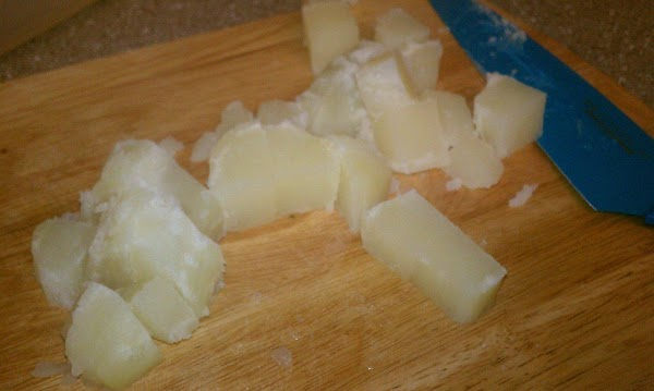 Chop up pototes, into cubes. and diced up eggs. place in a large bowl....