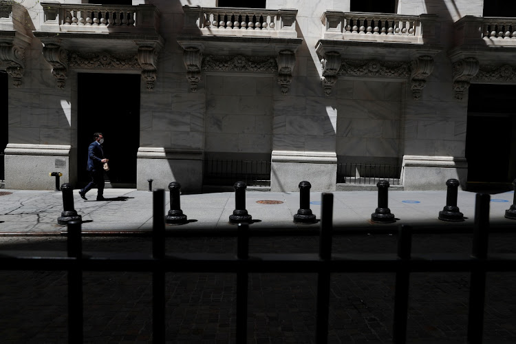 A trader walks outside the New York Stock Exchange in New York City, the US. Picture: REUTERS/SHANNON STAPLETON