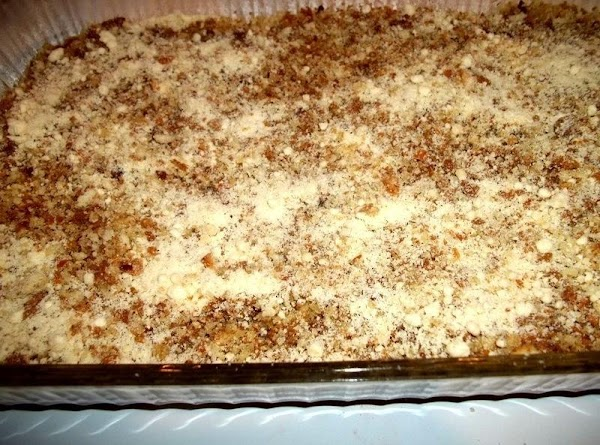 Make your stuffing mixture by pouring crumbs in a large bowl. Season the crumbs...