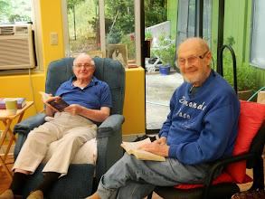 Photo: Arly and Joe reading in the solarium