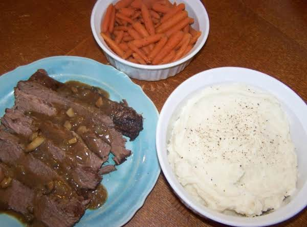 Guinness Beef Brisket With Guinness Mushroom Onion Gravy And Brown Sugar Braised Carrots Recipe