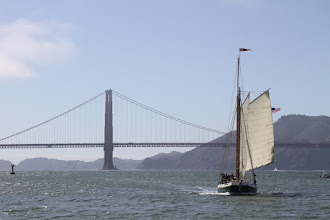 Photo: A charter sail boat plows through the race course seemingly oblivious to the race.