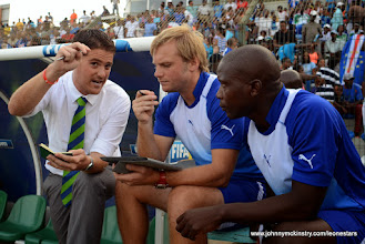 Photo: Leone Stars Head Coach Johnny McKinstry talks with Assistant Coaches Tom Harris and John Keister at half-time (Leone Stars) [vs. Cape Verde, June 2013 (Pic: Darren McKinstry)]