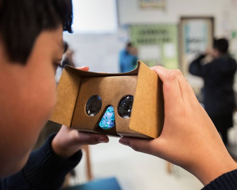 kid with a Google Cardboard