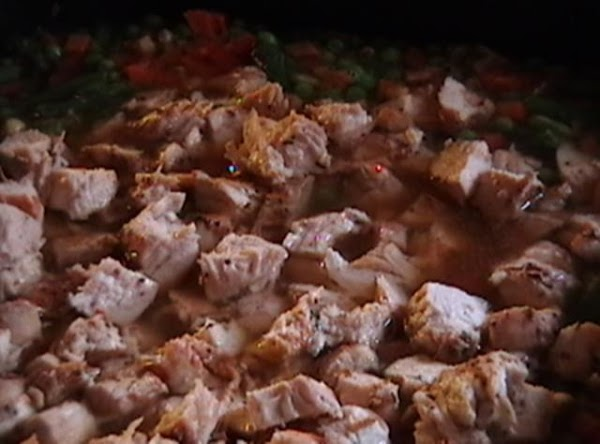 Cut the chicken into cubes and add back into pan, continue cooking for approx...