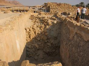 Photo: Half-excavated cistern at Qumran