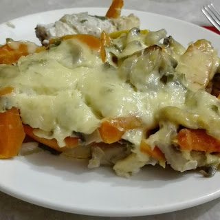 Roasted Fish with Mushrooms Under Cheese