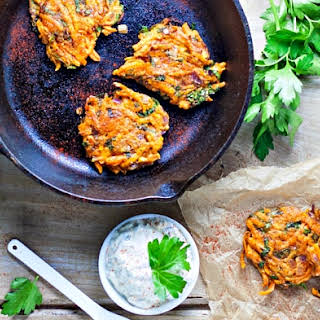 Sweet Potato Kale Latkes with Lemon Green Onion Parsley Sauce.