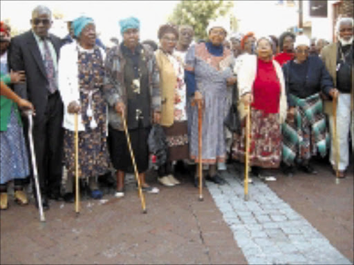 OLD IS GOLD: Dressed to the nines, these senior citizens who may have been homeless, have found a place to call home and find love - Phuthaditjaba-Qoqizizwe in Alexandra. 19/11/08. © Sowetan.