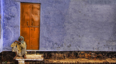 Photo: Man sitting by door in the middle of the afternoon in northern India.