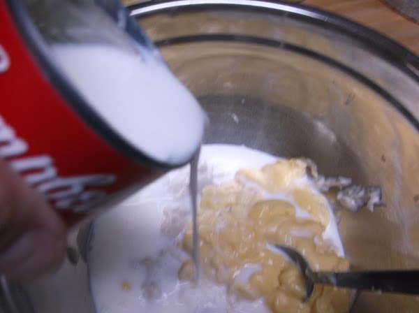 Gradually mix in 1 can of milk.