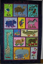 "Photo: Bernadine Farrow of Shawnee, Kansas made this adorable, colorful Jungle Walk quilt for her granddaughter who is 4 yrs. old. It hangs on ""her"" bedroom wall in Bernadine's house now for her to enjoy. We love this interpretation of our pattern. Thanks Bernadine"