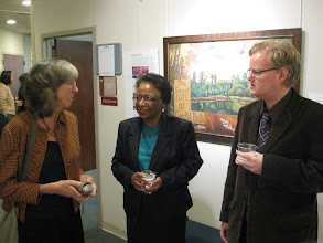 Photo: Terry Daulton, Dr Cora Marrett, and another person at the opening, in front of Terry's pastel painting, The Secret Life of Crystal Bog