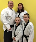 Mr. Wood and his kids in karate uniforms