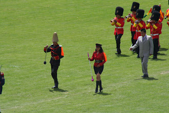 Photo: I'm not sure how she managed to walk on the field in those boots!