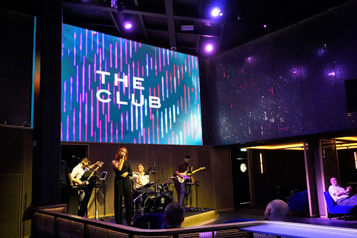 celebrity-edge-The-Club-1.jpg - You'll always find a party at The Club on decks 4 and 5 featuring the house band, Impulse, along with game show contests and a late-night DJ.