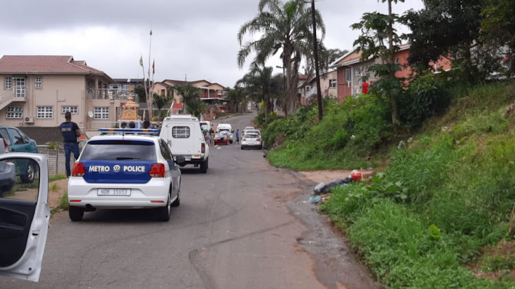 The scene on Taurus Street in Shallcross, south of Durban, where two men were beheaded and their bodies burnt on Monday.