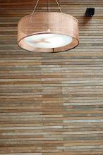Photo: Copper mesh pendant lights add a subtle sparkle against the wood paneled walls