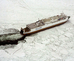 """Photo: A handout photo released by the Swedish Coast Guard on March 4, 2010 shows a  large cargo ship stuck in the ice in the Baltic Sea on the same day.  Around 50 ships, including large ferries  carrying thousands, were stuck in the ice in the Baltic Sea and many were not likely to be freed for hours, Swedish maritime authorities said. """"Around 50 commercial vessels are waiting for help from ice breakers (and) we have had as many as six large passenger ferries stuck, but have managed to free two of them,"""" Johny Lindvall of the Swedish Maritime Administration's ice breaker unit told AFP.Sweden's TT news agency first reported that the two largest ferries, the Isabella and the Amorella, were in total carrying 2,630 passengers, but later revised the number to 1,841.AFP PHOTO/ HO/Swedish Coast Guard/STRINGER"""
