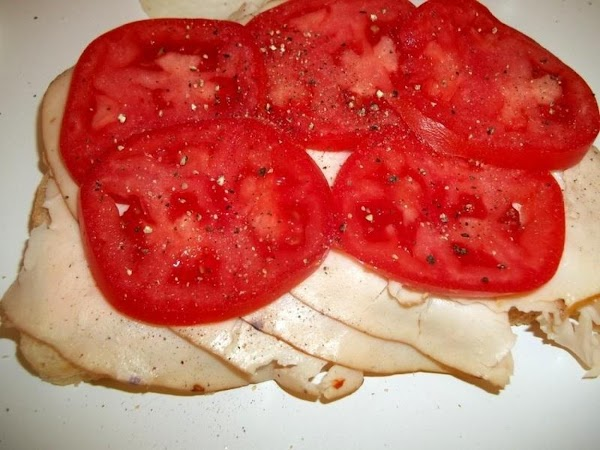 Next, spread out the tomato slices, salt & pepper.