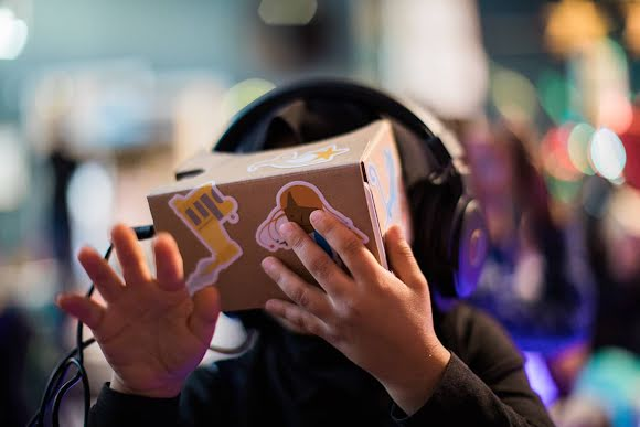 Student watching the 360-degree story through Cardboard