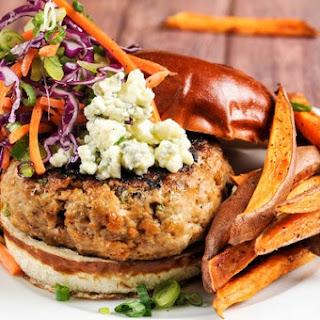 Buffalo Turkey Burger with blue cheese, sweet potato wedges, and celery slaw