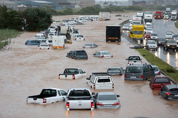 Vehicles stuck in high storm water in Prospecton Road, south of Durban on October 10, 2017.