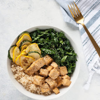 Almond Butter Tofu Bowl with Kale and Summer Squash.