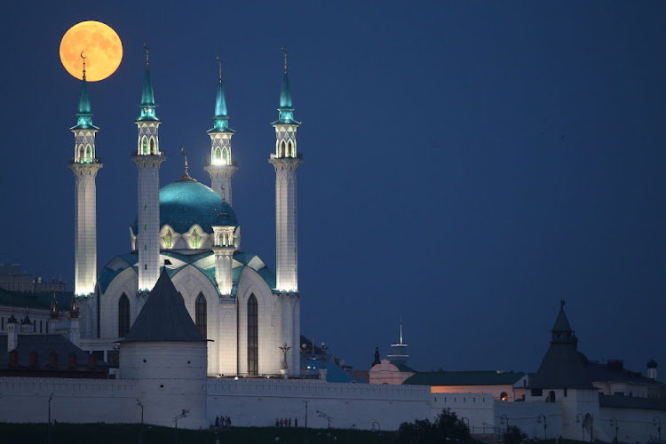 A blood moon over the Qolsarif Mosque on July 27 2018 in Kazan Russia.