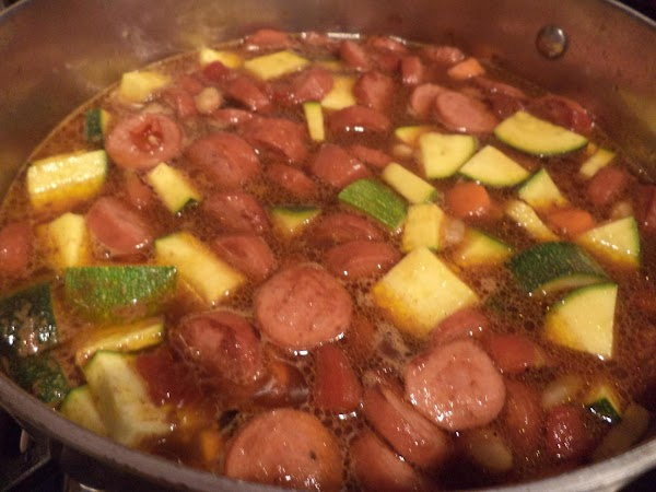 Stir in beans and zucchini.  Simmer until carrots and zucchini are tender.