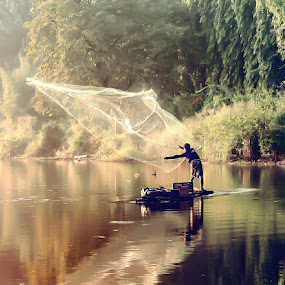 early morning fishing by Deny Satria - People Street & Candids ( village, indonesia, lake, traditional, fishing, fisherman )
