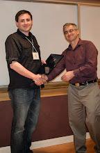 Photo: Paul Pearce accepting the EECS Outstanding GSI Award.