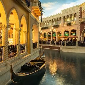 Gondola Awaits by Eric Yiskis - City,  Street & Park  Markets & Shops ( water, interior, markets, columns, boat, restaurant, canal, venetian, las vegas, gondola, shops, nevada, casino, hotel )