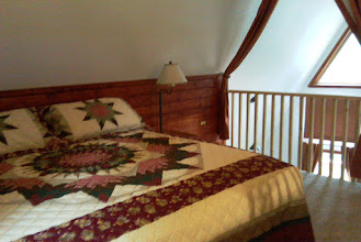 Photo: Cabin 7 upstairs bedroom view king bed or twins.  Also a full day bed downstairs.