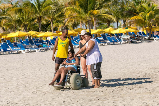 beach-accessible-wheelchair.jpg - Using a beach-accessible wheelchair at Harvest Caye in Belize.