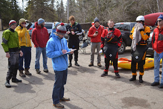 Photo: Lester River Race organizer Ryan Zimny goes through the pre-race instructions. Kayakers were put into two heats. While the first heat raced down the river, the other heat was positioned below each of the larger rapids with safety lines.