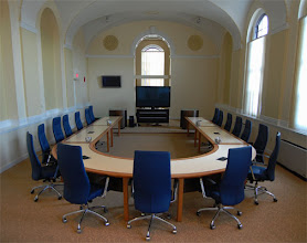 Photo: Our 1500 sqft conference room that used to be the chapel. Aside from the ornate decor, a couple cool features of this room are our 72inch monitor and 48-ft U-shaped conference table (with umlaut-shaped podiums)