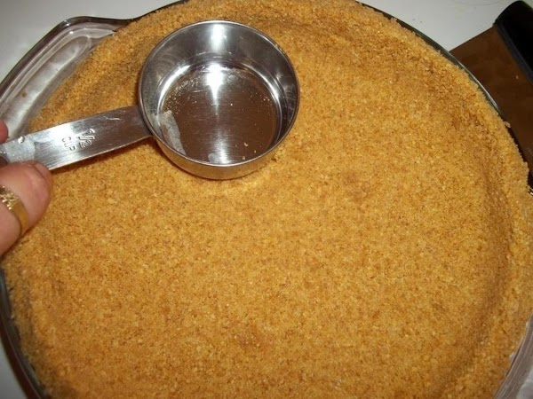 Place in 9 inch pie crust. I then use a metal measuring cup to...