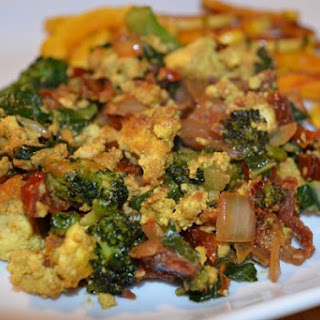 Cheesy Tofu Scramble With Spinach [Vegan].