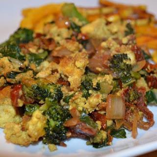 Cheesy Tofu Scramble With Spinach [Vegan].