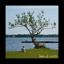 Photo: Girl under a tree by the lake.