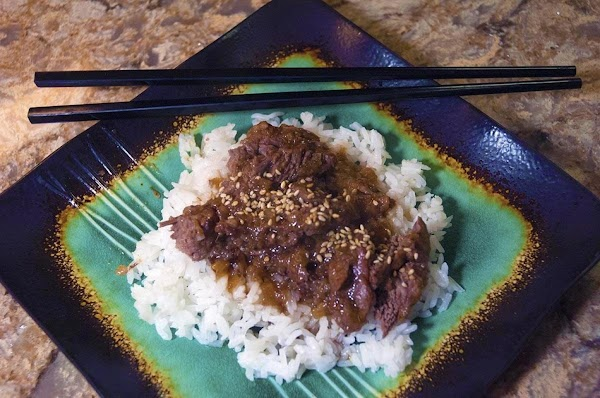 Cube or shred the beef, serve over long-grained white rice or egg noodles, and...
