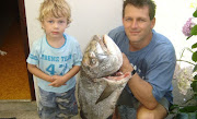 Francois Malherbe, when he was little, and his father Donnie who caught a mussel cracker.