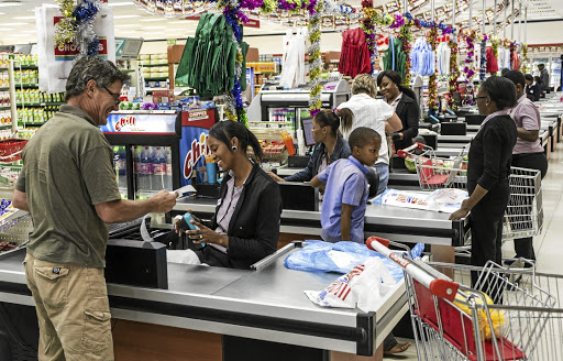 Banks say retailers have welcomed the introduction of contactless cards, which can reduce the length of queues at checkout points. There is a R500 upper limit on transactions. Picture: Bloomberg