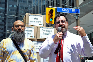 Photo: Paul Slansky, Mohammad Mahjoub's lawyer, speaking beside his client in front of the Department of Justice building in downtown Toronto.