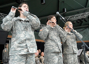 Photo: Staff Sgt. Jennifer Duncan, Spc. Shannon Kroenke and Staff Sgt. Jennifer McDonald play the piccolo during the 34th Red Bull Infantry Division Band's performance at the Minnesota State Fair's Military Appreciation Day Aug. 30, 2011 in St. Paul, Minn.