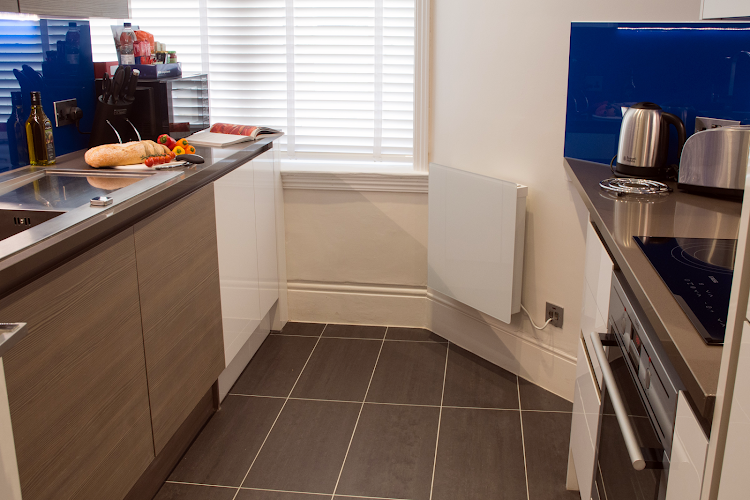 Fully equipped kitchen at Charing Cross Road Apartments
