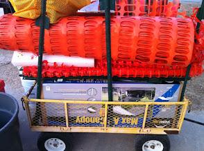 Photo: Orange fence and cart