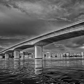John Ringling Causeway by Joe Saladino - Black & White Buildings & Architecture ( monochrome, causeway, bridge, skyline, water )